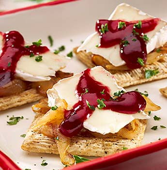 TRISCUIT Bites with Brie and Raspberry Glaze